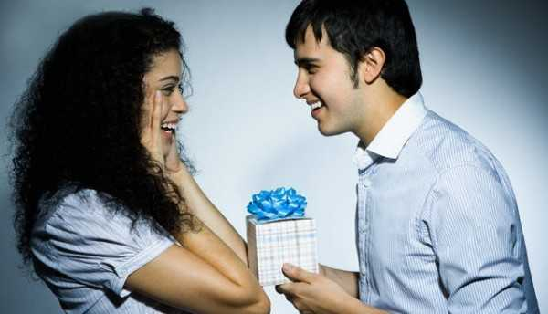 Young Man Giving Young Woman a Present --- Image by © Rob Chatterson/Corbis