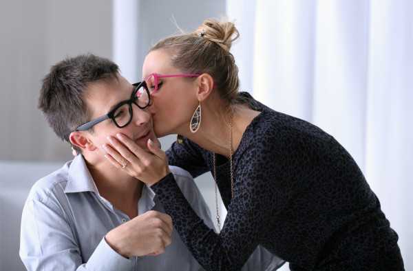 happy young couple kissing in the office with colored glasses