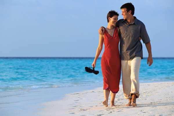 Couple Strolling on Beach ca. 2000 Maldives